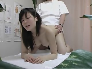 Masseur taking of Asian girl..
