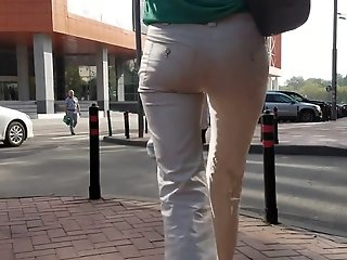 Slim woman s ass in white..
